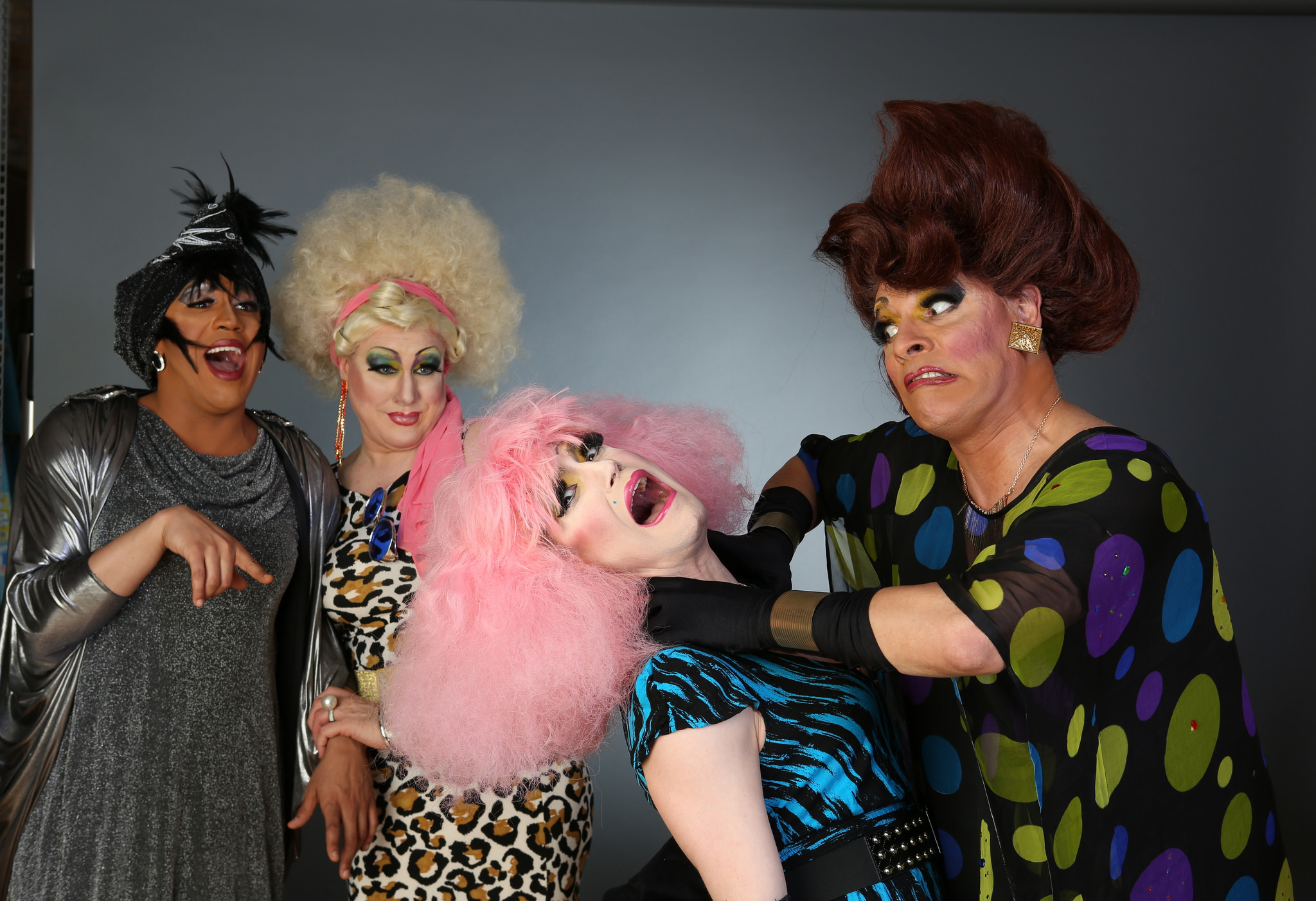 From right- Crystal Pain (David Cerda) has a moment with the ultra-annoying Bailey Legal (Kristopher Bottrall) as Gloria Blaze (Ed Jones) and Sissy Jizzmore (Jamie Smith) cackle in delight in Hell in a Handbag Productions MIRACLE! by Dan Savage, a drag parody of The Miracle Worker.     Photo by Rick Aguilar Studios.
